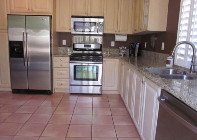 Kitchen cabinet makeover breezy designs for Airless paint sprayer for kitchen cabinets