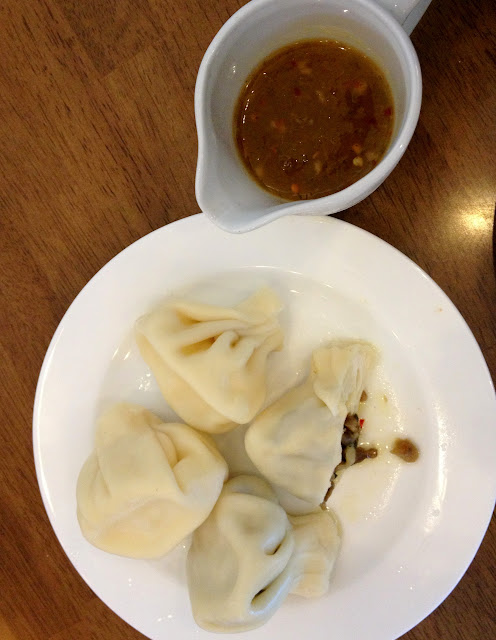 Khinkali with tkemali sauce