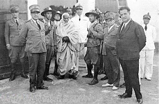 https://i1.wp.com/lh5.googleusercontent.com/_hFyIVHLPW40/TaYfL-07hRI/AAAAAAAAG54/T6ceYNvpvKo/Omar_Mokhtar_arrested_by_Italian_Fascists.jpg?w=584&ssl=1
