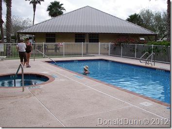 Kay making a new friend around the pool and spa.  Bentsen Palm Village RV Resort
