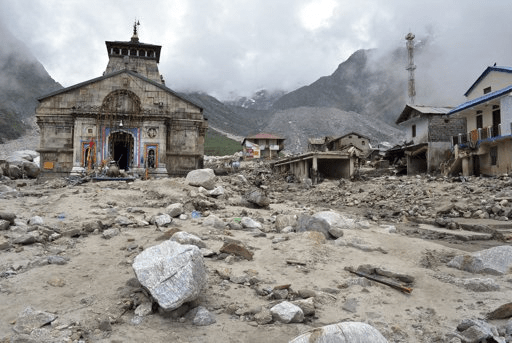 In this 20 June 2013 photo, the Kedarnath shrine, one of the holiest of Hindu temples dedicated to Lord Shiva, and other buildings around it are seen damaged following monsoon rains in at Kedarnath in the northern Indian state of Uttrakhand. A joint army and air force operation evacuated thousands of people stranded in the upper reaches of the state of Uttrakhand where days of rain had earlier washed out houses, temples, hotels, and vehicles. Photo: AP
