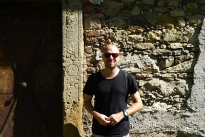 Me next to a wall I presume was old because it was attached to a really old church.