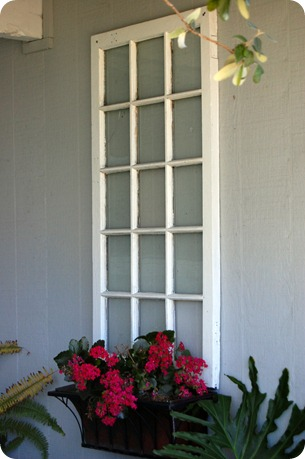 This is gorgeous! Turn an old discarded window into a new window box! I love garden art!