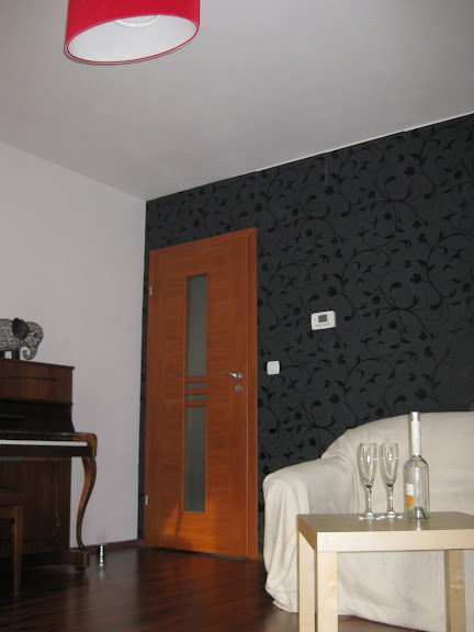 Living room - feature wall with black floral wallpaper