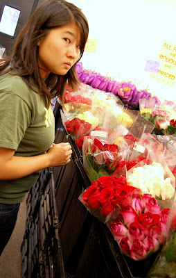 Doesnt she looked thrilled to be picking out flowers?!