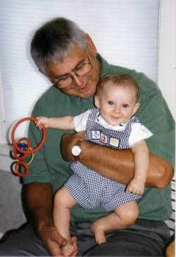 George Madzia with a grandchild in 1999
