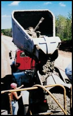 Fig .8. Truck agitators are also used with central-mix batch plants. Agitation mixing capabilities allow truck agitators to supply concrete to projects with slow rates of concrete placement and at distances greater than non-agitating trucks.