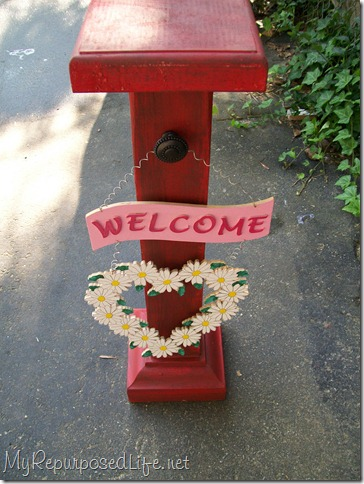 small porch post with welcome sign