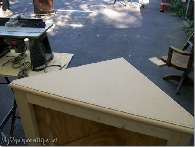routered top added to corner cabinet
