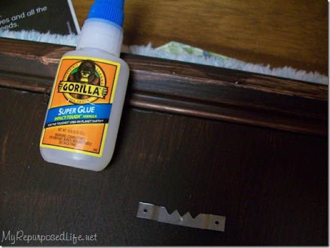 use gorilla super glue to add a saw tooth hanger