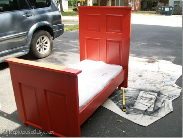 toddler bed made from a door using a crib mattress