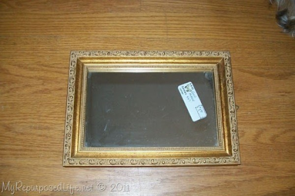 gold thrift store mirror