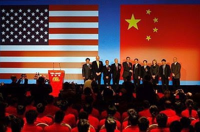 US and Chinese officials end an event to mark the opening of Wal-Marts 100th store in Beijing. China said Tuesday it hoped regular high-level economic talks with the United States will continue under president-elect Barack Obama, describing them as an important way to maintain good relations. (AFP/File/Teh Eng Koon)
