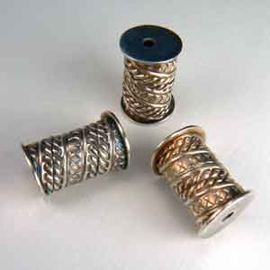 Three spool-shaped beads.