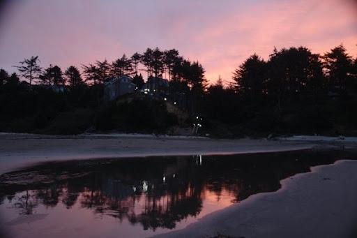 Steph got a nice reflection during the moonset/sunrise near Agate beach.