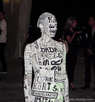 Model in white and black body paint - foreign languages and words - MAC Pro Makeup Event