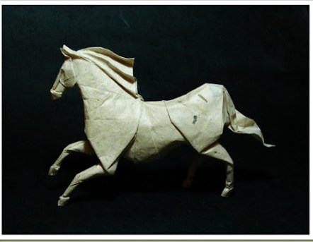 Origami horse Designed by Roman Diaz. Folded from 40*40 cm mc treated handmade paper.