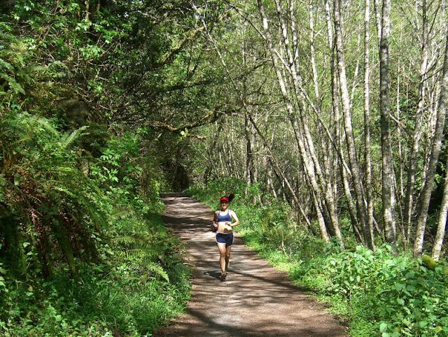 Serena running thrugh lush environs