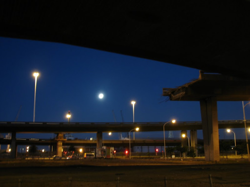 The unfinished highway with the bright moon in the sky