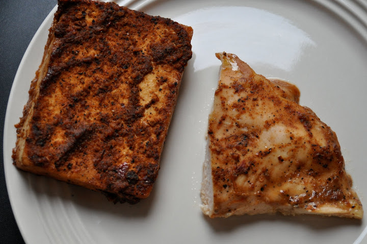 tofu and chicken, on the same plate for one time only.