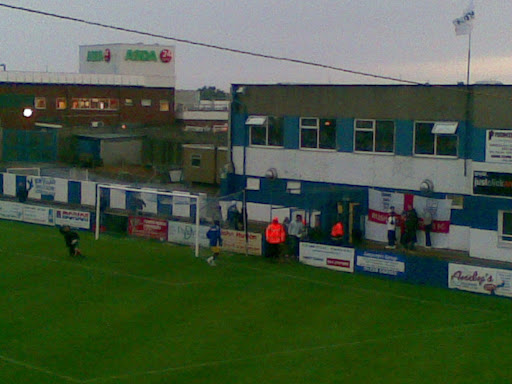 The Rushden end, with flags.