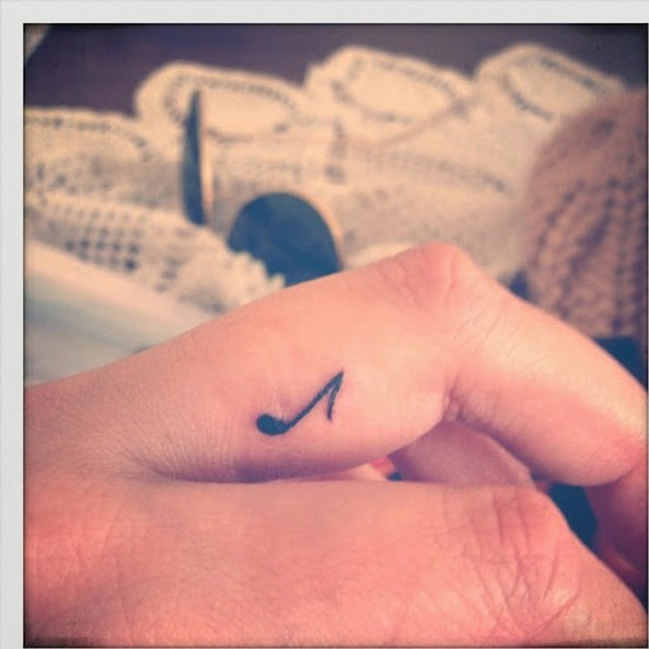 small music note tattoo on finger