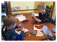 snow day paper play fun - cutting and drawing at https://momistheonlygirl.com