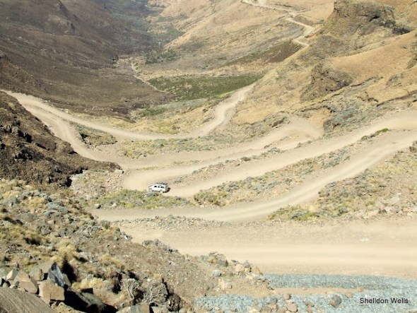a 4x4 vehicle negotiating the bends down the top of sani pass