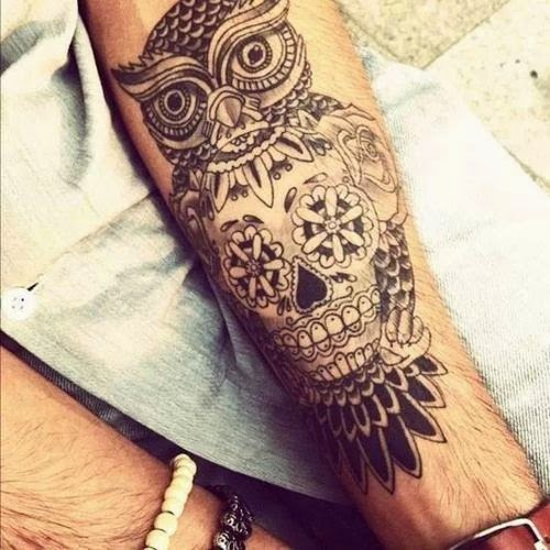 illuminati Owl tattoo design on arm with sugar skull design