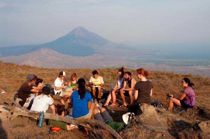 Sitting around campfire for dinner during El Hoyo Trek