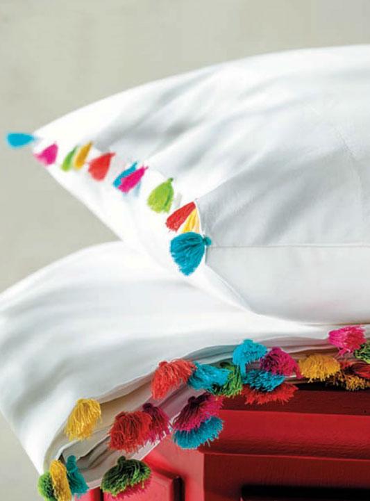 Borlas decorando toallas y sábanas.