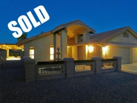 picture of Sun Lakes AZ Real Estate luxury home at night