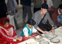Volunteers inside Bangla Sahib Gurudwara langar kitchen, Delhi, India