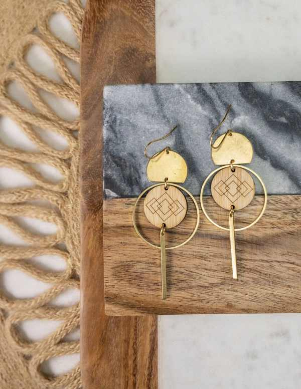 brass and bamboo earrings on coaster