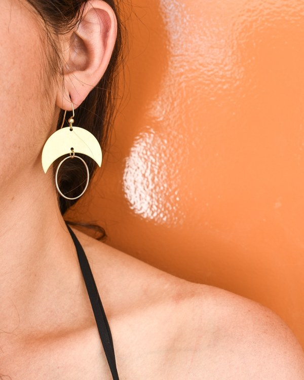 brass moon with silver hoop earrings