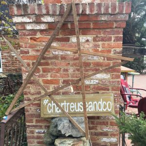 outdoor display featuring a sign with the chartreuse and company hashtag