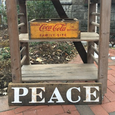 "rustic holiday sign that reads ""peace"""