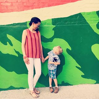 Mother and son posing in front of the Watermelon House mural on Q Street in Washington DC