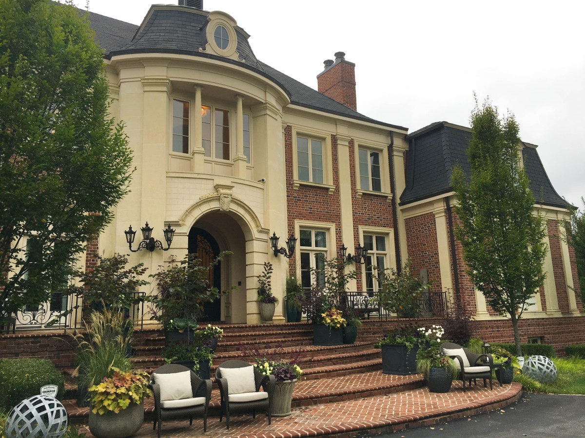 An exterior view of the grand front entrance of the 2017 DC Design House, a mansion located in Potomac, Maryland.