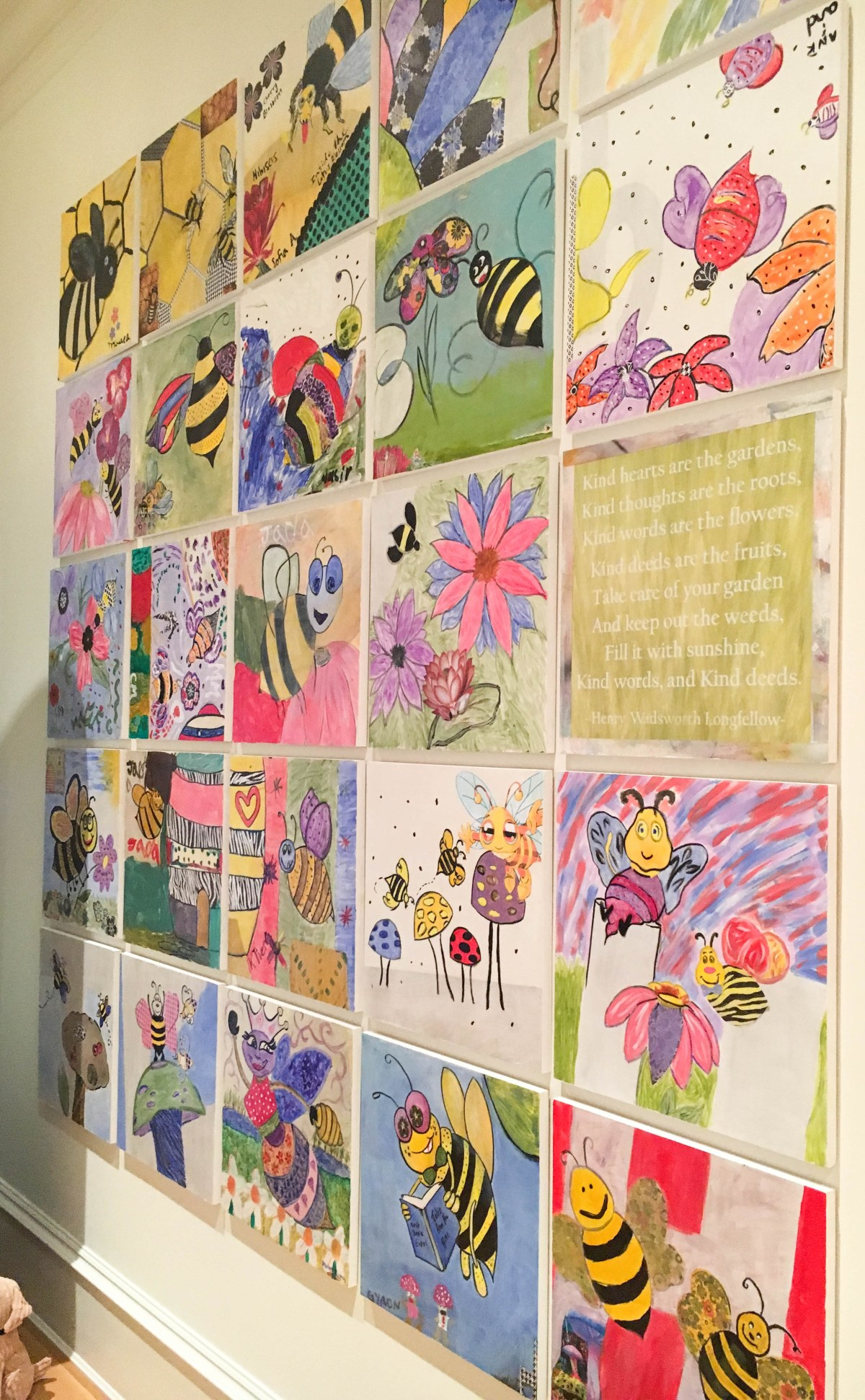 A beautiful and emotional gallery wall installation featuring paintings with a bee theme by patients, caregivers, staff, and volunteers of Children's National Health System.