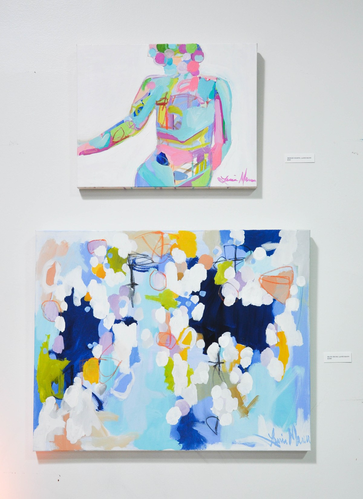 A close-up of two small paintings by abstract artist Lanie Mann, hanging one on top of the other for an exhibition in Washington DC