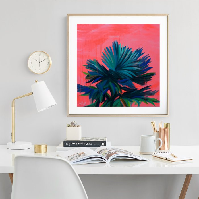 A bright piece of tropical art stands out in this modern and minimalistic office space with white furniture and accessories.