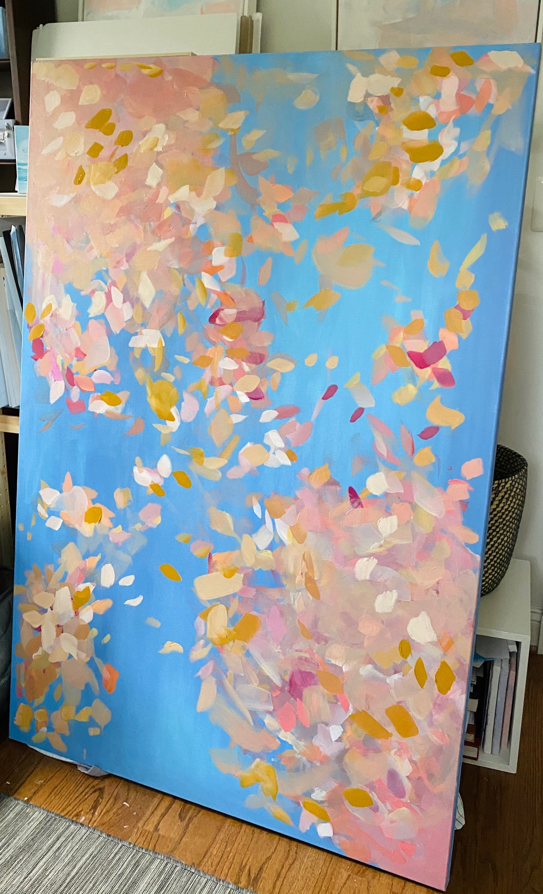 blue canvas with multi colored strokes to display as leaves falling