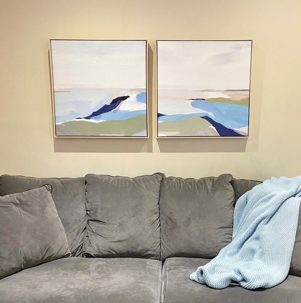 This set of 2 framed canvases from Target show an abstract landscape in a watercolor-style.