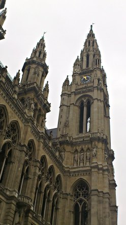 "Detail, Rathaus (Vienna City Hall), in Neo-Gothic style. On top of the central tower is the ""Iron Knight of City Hall"" (Eiserner Rathausmann) is one of the symbols of Vienna."