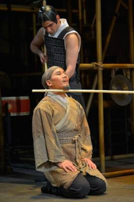 Cheng Ying (BD Wong), a country doctor is threatened by guards (Nick Gabriel) in American Conservatory Theater's production of 'The Orphan of Zhao'. Photo by Kevin Berne.