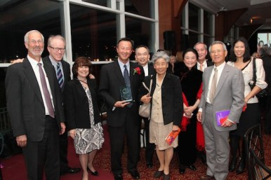 2015 Justice in Action honoree John Kuo and entourage at the Asian American Legal Defense and Education Fund's lunar new year gala at Pier Sixty at Chelsea Piers in New York on February 23, 2015. Photo by Lia Chang
