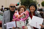 Russell Chang and Thel Wong celebrate granddaughter Asia Flores' high school graduation from Mercy High School on May 31, 2014 in San Francisco. Photo by Lia Chang