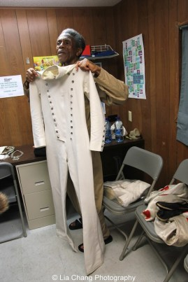 André De Shields displays his original costume from the Broadway production of The Wiz backstage at at The Wiz is 40 at Rumsey Playfield, Summerstage in New York on August 12, 2015. Photo by Lia Chang