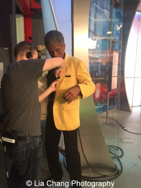 Derek Henkle mics up André De Shields at the WGN Studios in Chicago on November 9, 2015. Photo by Lia Chang